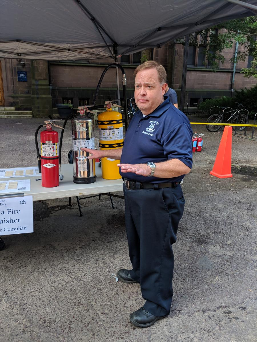 Fire marshall teaches researchers about identifying fire extinguishers